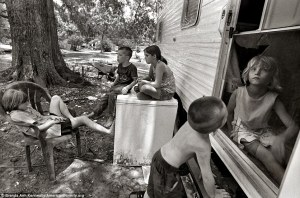Children sit around their beat-up trailer in Louisiana. (2008)
