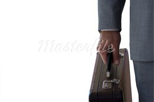 An African-American male holds a briefcase.