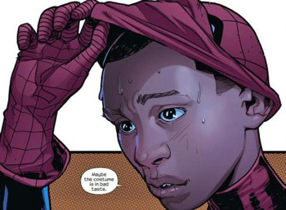 Image of marvel's new biracial Spider-man revealing his face from underneath his mask.
