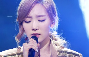 "Taeyeon performing ""Missing You Like Crazy"""