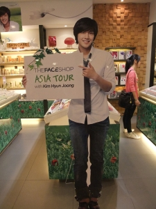 Kim Hyun Joong life-size cut board outside of a The Face Shop store