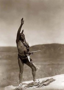 A Plains Indian man praying, showing the simplicity of their culture