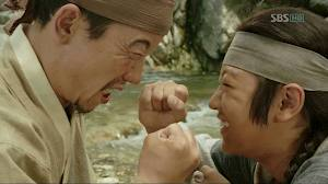 Ddol Bok teaching his father, Suk-Sam to stand up for himself